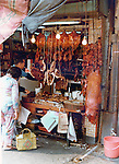 Open butchers shop, Pictures taken in Hong Kong. China in 1977 at the time of the cultural revolution.