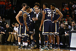 02 January 2016: Notre Dame head coach Mike Brey (center) talks to his players during a timeout. The University of Virginia Cavaliers hosted the University of Notre Dame Fighting Irish at the John Paul Jones Arena in Charlottesville, Virginia in a 2015-16 NCAA Division I Men's Basketball game. Virginia won the game 77-66.