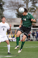 Adam Rice (14) of the Dartmouth Big Green heads the ball. Dartmouth defeated Monmouth 4-0 during the first round of the 2010 NCAA Division 1 Men's Soccer Championship on the Great Lawn of Monmouth University in West Long Branch, NJ, on November 18, 2010.