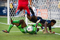 Sheanon Williams (25) of the Philadelphia Union collides with Chicago Fire goalkeeper Sean Johnson (25) after Johnson denied Williams on a scoring chance. The Chicago Fire defeated the Philadelphia Union 3-1 during a Major League Soccer (MLS) match at PPL Park in Chester, PA, on August 12, 2012.