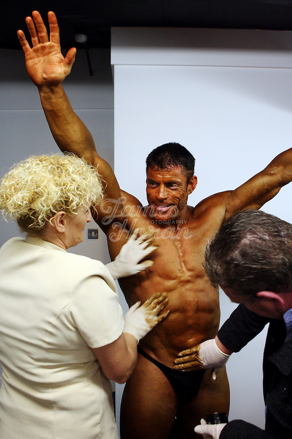 Michael Sheehan from Galway, winner of the heavyweight - 90kg + category, is pictured getting his fake tan applied before going on stage at the RIBBF (Republic of Ireland Body Building Federation) National Championships held in Limerick at the Millennium Theatre, LIT, Ireland