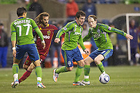 Seattle Sounders FC forward Mike Fucito looks to pass the ball in front of teammates forward Fredy Montero and midfielder Erik Friberg while Real Salt Lake midfielder Kyle Beckerman pursues during play in a Major League Soccer Wester Conference Semifinal match at CenturyLink Field in Seattle Wednesday November 2, 2011. The Sounders won the match 2-0, but lost the series.