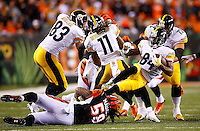 Antonio Brown #84 of the Pittsburgh Steelers is tackled by Rey Maualuga #58 of the Cincinnati Bengals in the first quarter during the Wild Card playoff game at Paul Brown Stadium on January 9, 2016 in Cincinnati, Ohio. (Photo by Jared Wickerham/DKPittsburghSports)