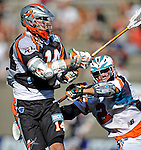 23 August 2008: Denver Outlaws' Midfielder Drew Westervelt (14) is checdked by Los Angeles Riptide Midfielder Jimmy Borell (2) during the Semi-Finals of the Major League Lacrosse Championship Weekend at Harvard Stadium in Boston, MA. The Outlaws edged out the Riptide 13-12, advancing to the upcoming Championship Game.. .Mandatory Photo Credit: Ed Wolfstein Photo