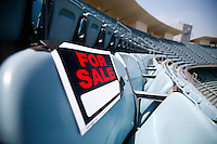 15 June 2011: FOR SALE sign on empty seat in the upper deck before a Major League Baseball game LA Dodgers vs the Cincinnati Reds at Dodger Stadium during a day game.  Staged Photo Illustration **Editorial Use Only**