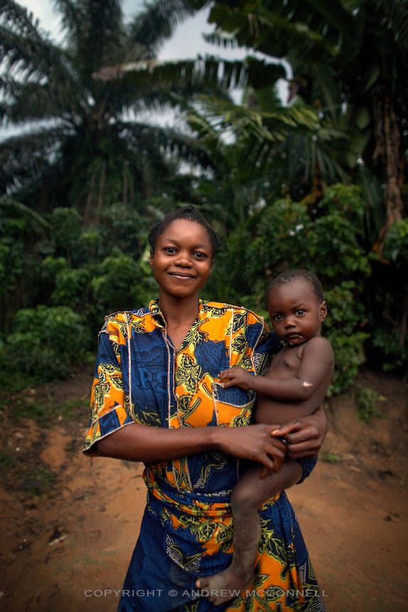 A mother and children pose for a picture at one the outer villages of Yamgambi, in DR Congo, on Sunday, Dec. 7, 2008. Villages are scattered throughout the 33 kilometers of Yangambi in clearings in the forest. The communities here live much as they have done for centuries, with no electricity and little access to the outside world.