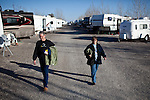&quot;Workampers&quot; Dan, left, and Vicky Suiker walk back to their RV from after showering at the Desert Rose RV Park on their day off from their seasonal job at the Amazon warehouse in Fernley, Nevada, December 13, 2011. CREDIT: Max Whittaker/Prime for The Wall Street Journal.AMAZONTOWN