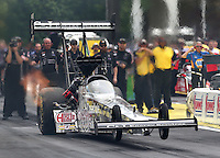 May 17, 2015; Commerce, GA, USA; NHRA top fuel driver Larry Dixon does a wheelstand as he launches off the starting line during the Southern Nationals at Atlanta Dragway. Mandatory Credit: Mark J. Rebilas-USA TODAY Sports