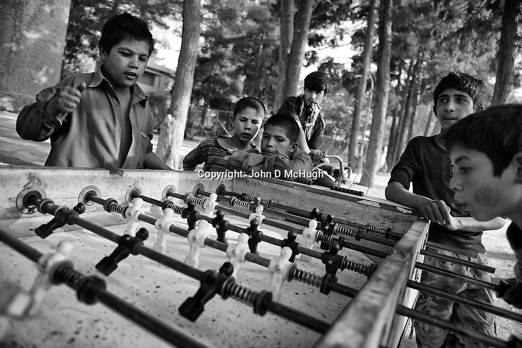 Young boys play table football in a park in Kabul, 16 August 2012. (John D McHugh)
