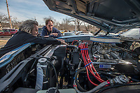 NWA Democrat-Gazette/ANTHONY REYES @NWATONYR<br /> Jack Davis and Jerry Taplin, owner of Cars, Guitars and Antiques, load a 1972 Ford Gran Torino Friday, Feb. 10, 2017 onto a trailer near his shop in downtown Bentonville. Tapin plans on trading the Torino for a 1946 Chrysler New Yorker.