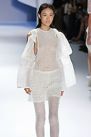 Shu Pei Qin walks runway in a White textures gauze drawstring vest, White silk chiffon eyelet tank, and White textured gauze legging, by Vera Wang, for the Vera Wang Spring 2012 collection, during Mercedes-Benz Fashion Week Spring 2012.