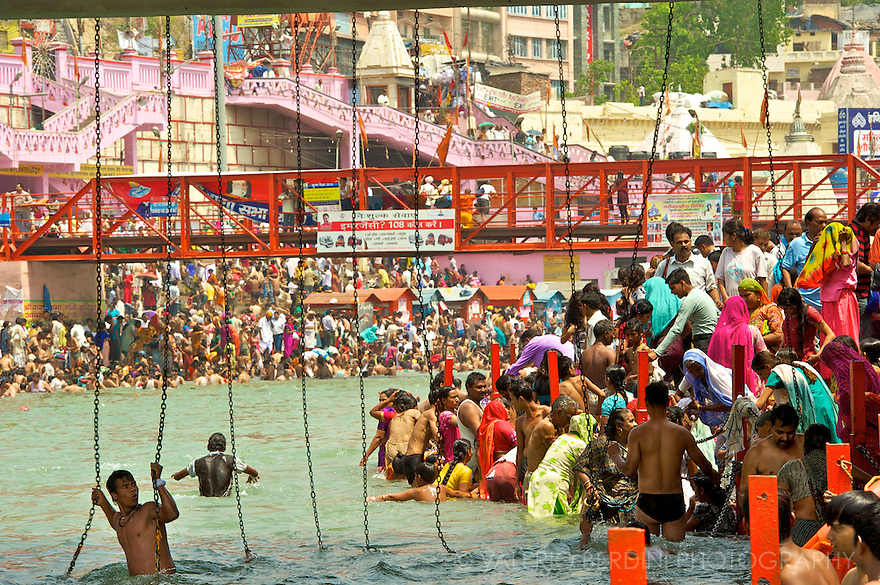 Chains hang from the bridges to help bathers holding in the fast-flowing waters. Several people drawn every Kumbh Mela.