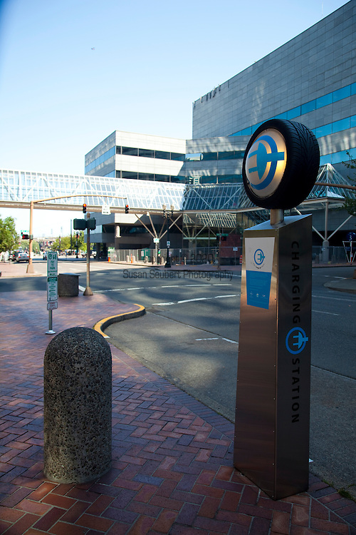 Electric car charging stations dot the downtown Portland parking spaces