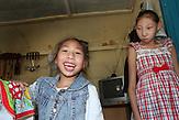 Die beiden Schwestern Amina (links) und Assylzhan Taitenowa in Semej (ehem.Semipalatinsk) . Beide leiden an Mikrozephalie. Im kasachischen Semipalatinsk führte die Sowjetunion Atomwaffentests durch. Bis heute gibt es Kinder dort, die  mit schweren Behinderungen zur Welt kommen. / The two sisters Amina (left) and Assylzhan Taitenowa in Semej (former Semipalatinsk). Both suffer from microcephaly. In Semipalatinsk in Kazakhstan the Soviet Union's tested nuclear weapons. Until today there are children there which were born with severe disabilities.