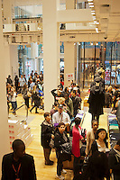 Customers on line at the grand opening of the Uniqlo Flagship store on Fifth Avenue in New York on Friday, October 14, 2011.  The store is a staggering 89,000 square feet on multiple levels and is Fast Retailing's second store in the United States with a third opening next week in the Herald Square shopping district. The largest store on Fifth Avenue filled to the brim with affordable clothing it competes with stalwarts such as the Gap and Zara which are in the immediate proximity. Fast Retailing plans on opening 200 to 300 stores worldwide until 2020 and currently has 1000 stores. (© Richard B. Levine)