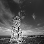 Summer skies over the ancient pepperpot lighthouse, Isle of Wight