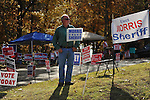 Gary Morris, candidate for sheriff of Lafayette County, Miss., holds a sign outside the polls at the Chamber of Commerce in Oxford, Miss. on Tuesday, November 8, 2011. Mississippians go to the polls today for state and local elections, as well as referendums including the so-called Personhood Amendment.