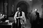 Pax Cake distribution, St Catherine's church, Hoarwithy, Hereford and Worcester. England 1974 Palm Sunday. The Revd. Idris Michael Evans, the Vicar of Hentland with Hoarwithy and Sidesman  Mr Stan Jones. The image on the Pax cake is the 'Agnus Dei', the Lamb of God.<br /> <br /> In the 1970s, Pax Cakes were distributed at both St. Catherine&rsquo;s Church (Chapel of ease) Hoarwithy and St Dubricius (Parish Church) Hentland.