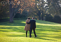 05 Nov 2010, Washington, DC, USA --- U.S. President Barack Obama and first lady Michelle Obama walk towards Marine One across the South Lawn of the White House. --- Image by © Brooks Kraft/Corbis