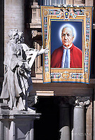 """A tapestry hanged on the facade of St Peter's basilica shows a portrait of Italian Alfonso Maria Fusco during a canonization mass.Pope Francis  leads a canonization mass on October 16, 2016 at St Peter's square in Vatican. Pope Francis canonises Argentine """"gaucho priest"""" Jose Gabriel Brochero today along with six others raised to sainthood : Salomon Leclercq, Jose Sanchez del Río, Manuel Gonzalez Garcia, Lodovico Pavoni, Alfonso Maria Fusco and Elizabeth of the Trinity."""
