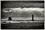 The pier at Grand Haven State Park in breezy conditions with the sun shining through overhead clouds. Photo by Dan Irving.