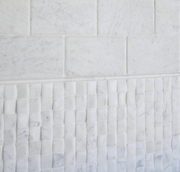 Timeworn Lucido Bianco Carrara<br /> Pencil Moldings in Statuary Carrara honed NRFRSPCIL-SCH, Timeworn Bianco Carrara 6 x 12 in bricks RFFRS15X30-TCR, <br /> Timeworn Bianco Carrara  2 x 2 in. bricks NRFRS2X2-TCR