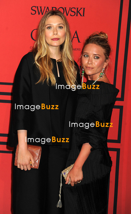 Elizabeth Olsen and Mary-Kate Olsen at the 2013 CFDA Fashion Awards.<br /> New York City, June 3, 2013.