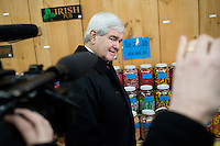 Former Speaker of the House Newt Gingrich and his wife Callista shop at a general store in Littleton, New Hampshire.  Gingrich is seeking the 2012 Republican nomination for president.