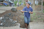 Rony Bacuyan digs a ditch for a water pipe as part of a cash for work program in the village of Cambayan in the Philippines province of Samar. The region was hit hard by Typhoon Haiyan in November 2013. Known locally as Yolanda, the storm left much of the community's infrastructure a shambles. Norwegian Church Aid, a member of the ACT Alliance, is helping the community rehabilitate its potable water system as well as build new toilets.