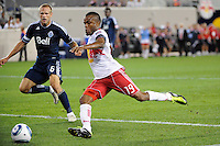 Dane Richards (19) of the New York Red Bullstakes a shot from close range. The New York Red Bulls  and the Vancouver Whitecaps played to a 1-1 tie during a Major League Soccer (MLS) match at Red Bull Arena in Harrison, NJ, on September 10, 2011.