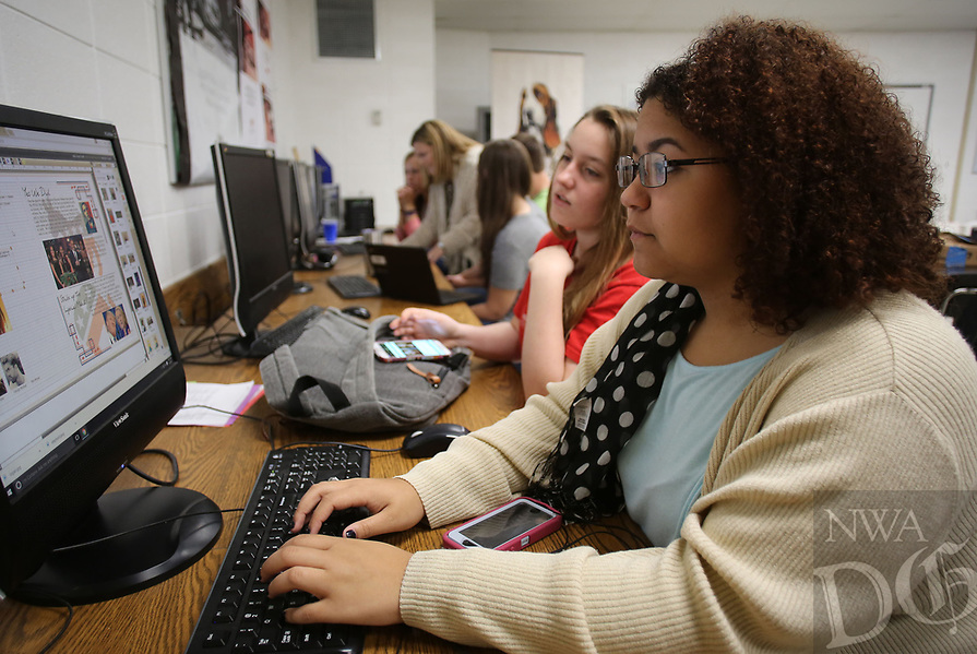 NWA Democrat-Gazette/DAVID GOTTSCHALK  Kirsten Keels (from right), a senior at West Fork High School, works  with Andrea Womack, a senior and editor, Friday, April 7, 2017, on the annual yearbook in Sarah Jones' Journalism Class at the school. The district has more seniors than kindergarten students. Some of the trend is because of an aging population in West Fork, a lack of jobs within the city and a lack of housing. The high school is working to expand offerings to students, despite being a small school.