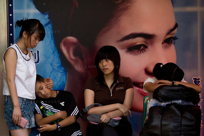 Locals take a break from shopping at a mall in Beijing, China on Friday, August 22, 2008.  Kevin German