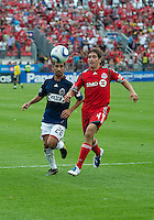 August 07 2010 Chivas USA midfielder Paulo Nagamura #26 and Toronto FC defender Nick Garcia #4 in action during a game between Chivas USA and Toronto FC at BMO Field in Toronto..Toronto FC won 2-1.