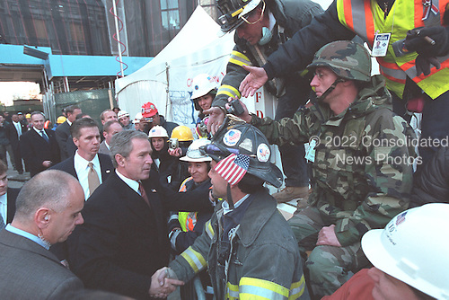 United States President George W. Bush meets one-on-one with firefighters after attending a memorial service in New York, New York on Sunday, November 11, 2001..Mandatory Credit: Eric Draper - White House via CNP.