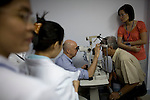 Dr. Steve Charles examines the eyes of Tho Nguyen, 66, while ophthalmologist Van Tham, right, watches along other Vietnamese doctors during a screening day at the Ho Chi Minh City Eye Hospital on Monday, April 14, 2008...ORBIS Flying Eye Hospital brought doctors, nurses and specialists from all over the world to Ho Chi Minh City, Vietnam from April 7-18, 2008.  The ORBIS program contributed to the efforts of Ho Chi Minh City Eye Hospital in fighting avoidable blindness by educating local ophthalmologists to diagnose and manage pediatric blindness, retinal disease, oculoplastics, and blindness due to glaucoma.