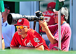 29 August 2010: Washington Nationals catcher Ivan Rodriguez watches play from the photo well as Washington Nationals team photographer Mitchell Layton works during a game against the St. Louis Cardinals at Nationals Park in Washington, DC. The Nationals defeated the Cards 4-2 to take the final game of their 4-game series. Mandatory Credit: Ed Wolfstein Photo