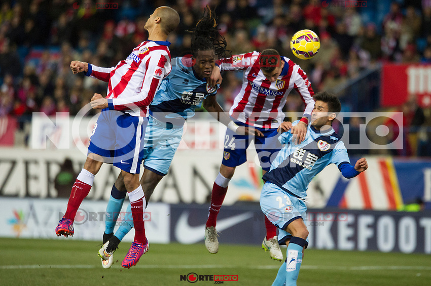 Atletico de Madrid&acute;s Gimenez and Guilherme Siqueira and Rayo Vallecano&acute;s Alberto Bueno and Abdoulaye Ba during 2014-15 La Liga match between Atletico de Madrid and Rayo Vallecano at Vicente Calderon stadium in Madrid, Spain. January 24, 2015. (ALTERPHOTOS/Luis Fernandez) /NortePhoto<br />