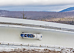 9 January 2016: Russian pilot Alexey Stulnev leads his 4-man team as they cruise through Curve 14 during their second run of the day at the BMW IBSF World Cup Bobsled Championships at the Olympic Sports Track in Lake Placid, New York, USA. Stulnev's team came in 7th for the day, with a 2-run combined time of 1:50.42. Mandatory Credit: Ed Wolfstein Photo *** RAW (NEF) Image File Available ***