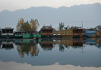 Dal Lake, famed for its ornately-carved cedar houseboats, is the centre piece of Srinagar?s tourist trade. But in the past two decades it has shrunk by more than half to 11 square kilometres and lost 12 meters in depth. Pollution is a big problem for the lake, in addition to the 7,500 people living on houseboats, another 50,000 people inhabit small islands in the area. Srinagar, Kashmir, India. © Fredrik Naumann/Felix Features