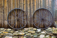 Vermont barn with rock wall and two antique wheels- lines and texture, New England