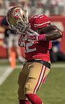 San Francisco 49ers running back Mike Davis (22) pretends to brush himself off to celebrate touchdown on Sunday, October 23, 2016, at Levis Stadium in Santa Clara, California. The Buccaneers defeated the 49ers 34-17.