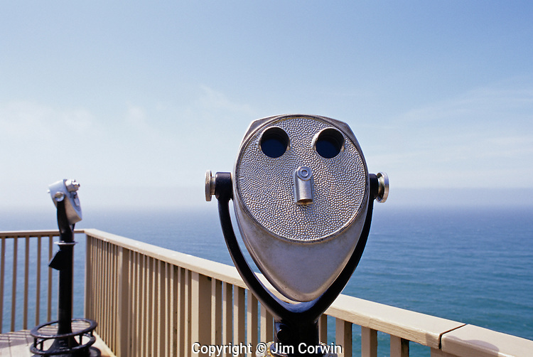 Sea lion caves outdoor observation deck looking over coastline close up of one of the binoculars Highway 101 along the Oregon State Coastline USA
