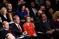 Former Rep. Gabrielle Giffords (D-AZ), center, listens as President Barack Obama delivers his State of the Union address in the U.S. Capitol on Tuesday, January 24, 2012 in Washington, DC.