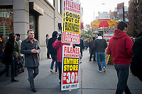 Advertising in Union Square in New York on Saturday, November 19, 2001 promotes the liquidation sale of the nearby Filene's Basement store. Syms Corp. and its affiliate Filene's Basement are under bankruptcy protection and are liquidating all their stock as the businesses are shut down. The 25 Syms and the 21 Filene's Basement stores are set to close in January 2012.  (© Richard B. Levine)