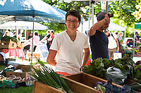 Hanna Jacobs of Matchbox Garden and Seed Co. selling her organically grown produce at a farmers market in Toronto