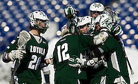 After scoring the game-winning goal Cooper MacDonnell (16) of Loyola is congratulated by teammates Collin Finnerty (20), Eric Lusby (12) and Stephen Murray (26) at the Navy-Marine Corp Memorial Stadium in Annapolis, Maryland.   Loyola defeated Navy, 8-7, in overtime.