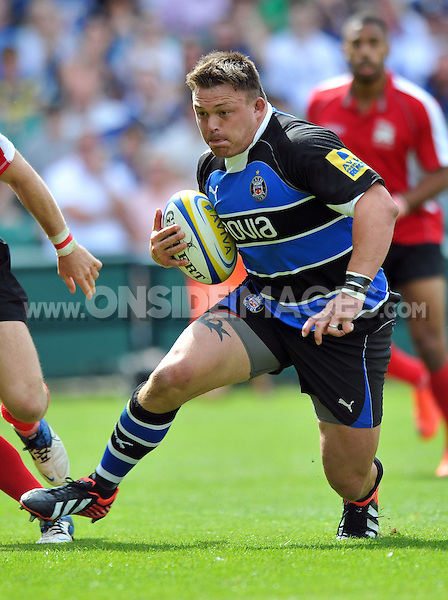 David Wilson in possession. Pre-season friendly match, between Bath Rugby and London Welsh on August 11, 2012 at the Recreation Ground in Bath, England. Photo by: Patrick Khachfe / Onside Images