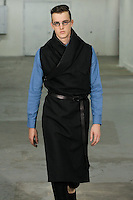 Model walks runway in an outfit by Siki Im from the Siki Im Spring/Summer 2012 collection, during New York Fashion Week Spring 2012, September 9, 2011.