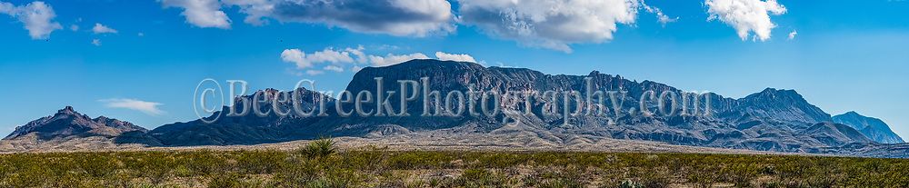 Chiso Mountains range panorama in Big Bend National Park on a nice cloudy day with blue skies over the desert landscape.