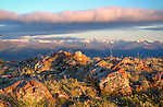 Idaho, East Central, Salmon, Leadore. Morning sun lights the lichen covered boulders atop a ridge in the Beaverhead Mountains of the Salmon Challis National Forest. Lemhi Range distant.